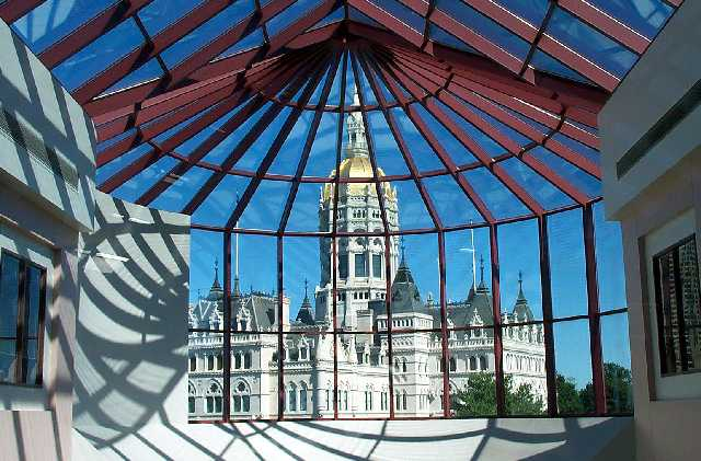 The Capitol as viewed through the Legislative Office Building glass ceiling.